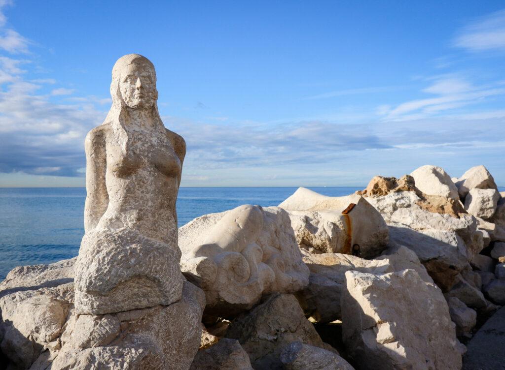 Stone mermaid statue in Piran, Slovenia