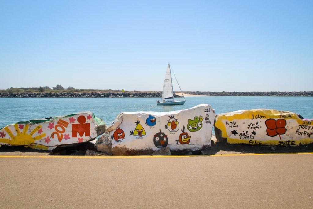 Painted rocks at the Port Macquarie breakwall